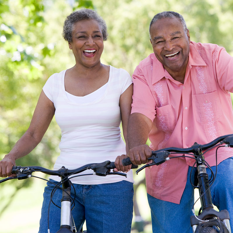 Retirement-age couple on bikes