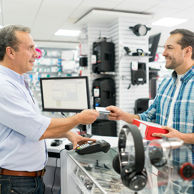 A man buys an electronic at a store