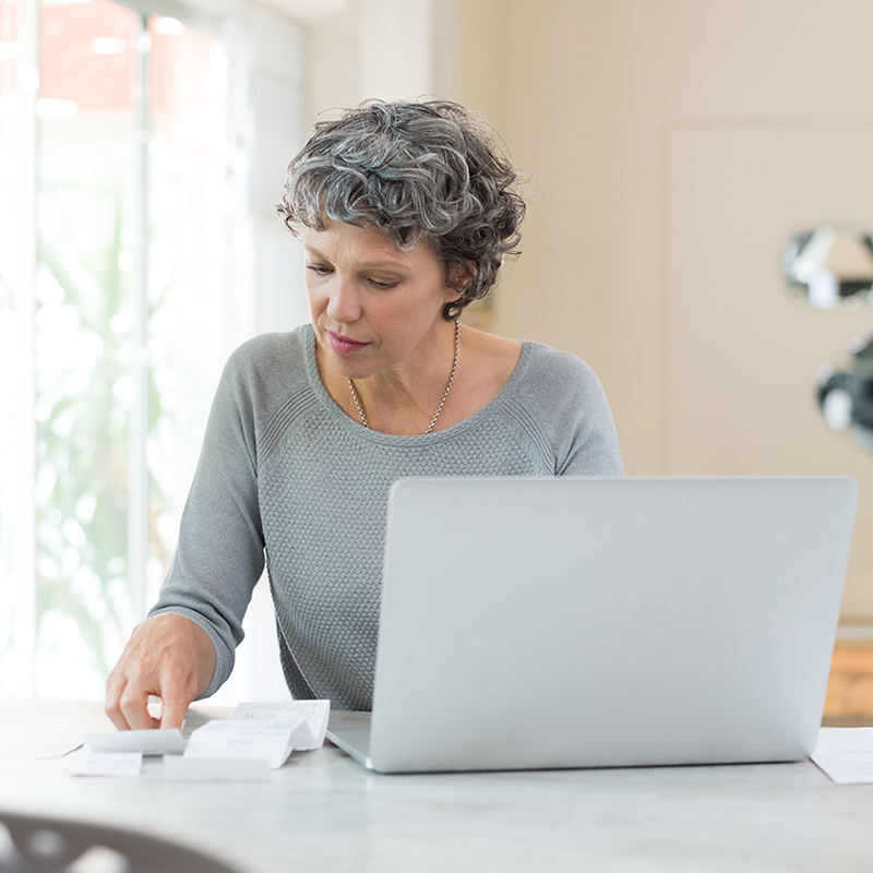 An older woman checks her finances