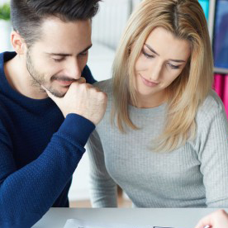 Couple reviewing credit report